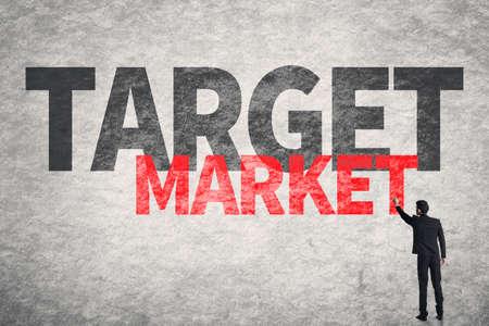 categorize: Asian business man write words on wall, Target Market