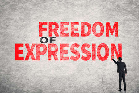 censure: Asian businessman write text on wall, Freedom of Expression
