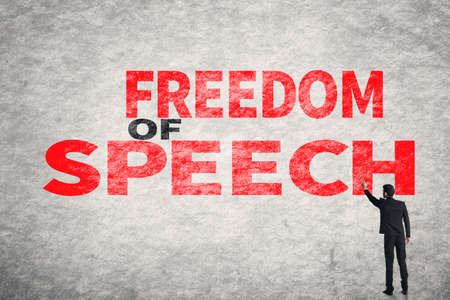 constitution: Asian businessman write text on wall, Freedom of Speech