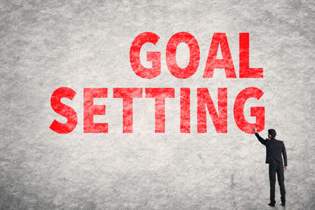 Asian businessman write text on wall, Goal Setting