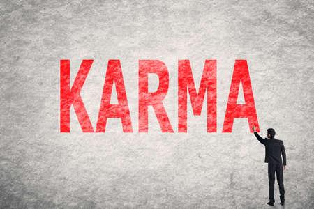 forthcoming: Asian businessman write text on wall, Karma Stock Photo