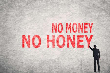 with no money: Asian businessman write text on wall, No Money No Honey
