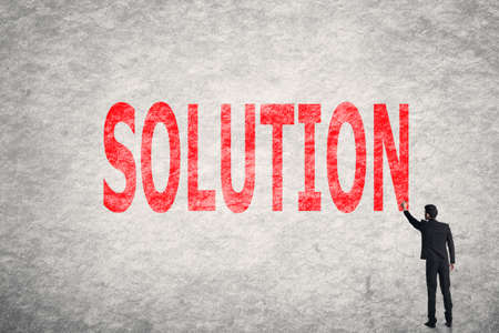Asian businessman write text on wall, Solution photo