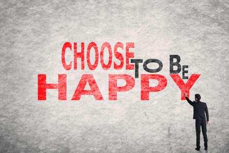 Asian Geschäftsmann Schreib Text an der Wand, Wählen Sie, glücklich zu sein