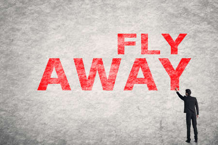 moving forward: Asian businessman write text on wall, Fly Away