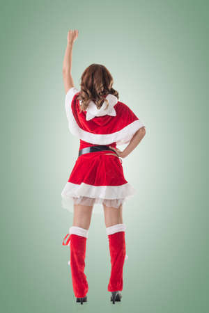 sexy xmas elf: Christmas woman relax, rear view, isolated. Stock Photo
