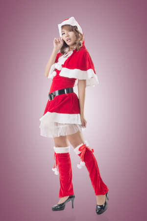 mrs santa claus: Sexy Christmas girl of Asian standing and smiling at the studio, full length portrait isolated. Stock Photo