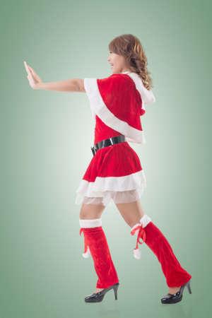 sexy xmas elf: Christmas girl push something, full length pose isolated.
