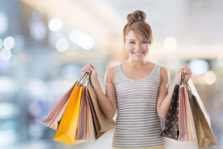 shopping sale: Shopping girl of Asian, closeup portrait isolated on white with clipping path. Stock Photo