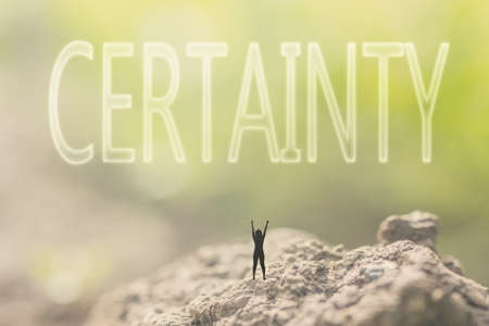 certainty: Concept of guarantee with a person stand in the outdoor and looking up the text over the sky in nature background. Stock Photo