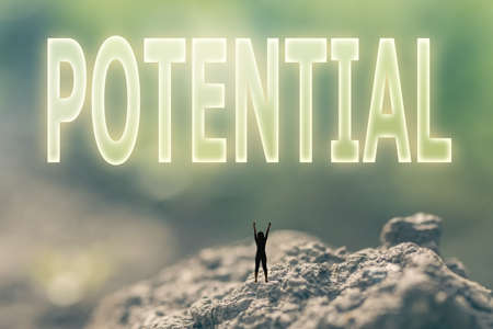 potentiality: Concept of ability with a person stand in the outdoor and looking up the text over the sky in nature background.
