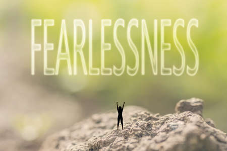 courageous: one person stand in the outdoor and looking up text on nature background, concept of courage Stock Photo
