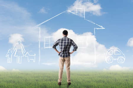 toward: Asian man look toward the drawing house and family in the heaven. Stock Photo