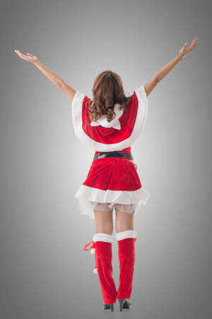 sexy christmas elf: Christmas woman relax, rear view, isolated. Stock Photo