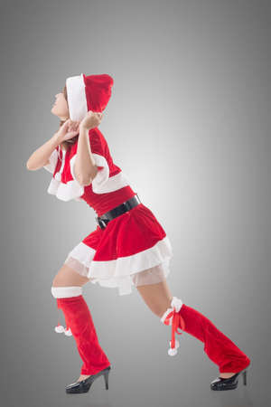 dragging: Christmas girl pull something, full length portrait.