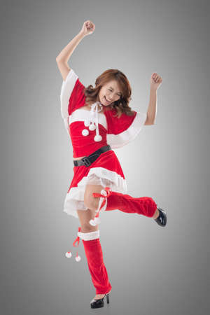 sexy xmas elf: Attractive Christmas lady of Asian woman, full length portrait. Stock Photo