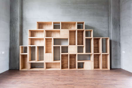 compartments: Empty wooden boxes on the ground in a room. Stock Photo