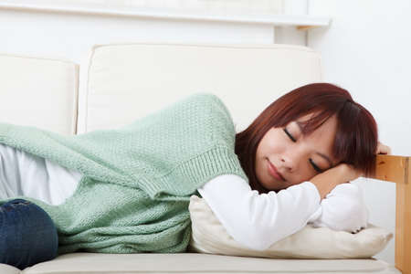 woman on couch: Sleeping girl of Asian lie on sofa in house.