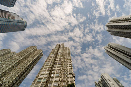 hk: Apartment buildings in daytime under sky in Hong Kong, China, Asia. Stock Photo