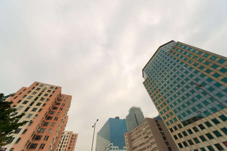 dwell house: Apartment buildings in daytime under sky in Hong Kong, China, Asia. Stock Photo