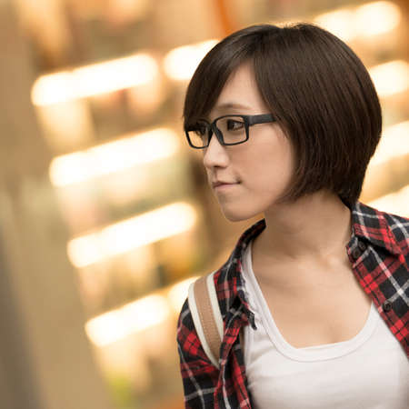 contemplative: Young girl of Asian at mall in Taipei, Taiwan. Stock Photo