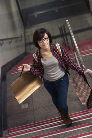 up stair: Attractive woman walk up on stair in Taipei, Taiwan. Stock Photo