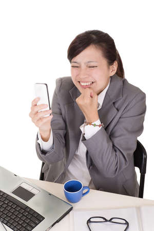 face work: Confident business woman using cellphone and sitting on chair at office on white background. Stock Photo