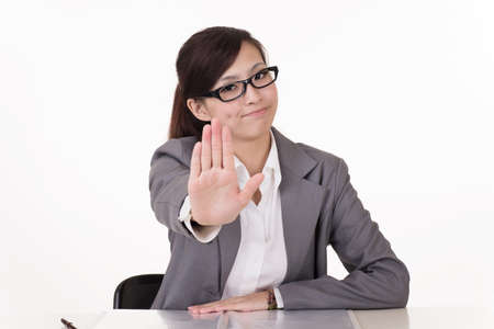 reduction: Asian business woman give you rejected sign, closeup portrait on white background.