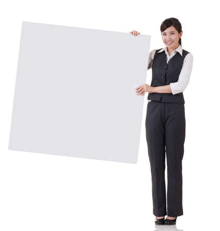 instruction sheet: Business woman holding blank board on white background. Stock Photo