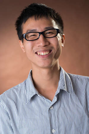frank: Young Chinese frank businessman, closeup portrait in studio.