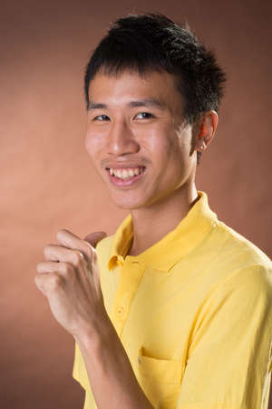 guileless: Cheerful young Chinese guy pointing at himself, closeup portrait in studio.