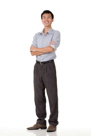 guileless: Young business man of Chinese, full length portrait in studio background.