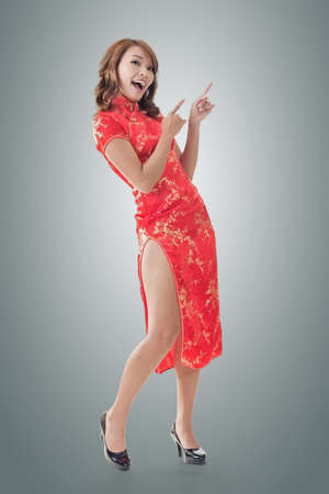 chinese dress: Chinese woman dress traditional cheongsam at New Year and introducing, full length portrait isolated.