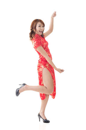 Attractive Chinese woman dress traditional cheongsam and hold something, full length portrait. photo