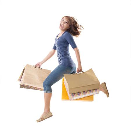 아시아 지주 가방, 절연의 쾌활 한 쇼핑 여자.