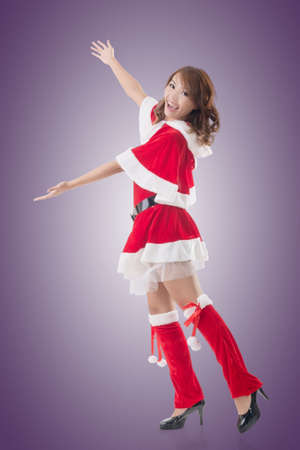 introduce: Smile happy Asian Christmas girl introduce, isolated full length portrait.