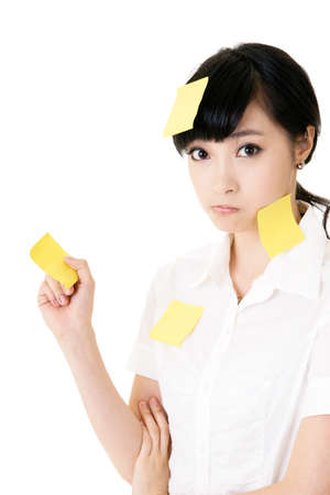 people problems: Business woman with many yellow memo note on her body, closeup portrait.