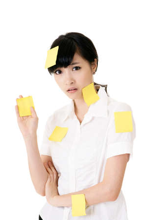 job posting: Business woman with many yellow memo note on her body, closeup portrait.