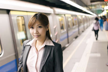 taipei: Asian young business woman in the MRT station, shot at Xinyi business district, Taipei, Taiwan.
