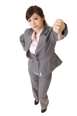 disagree: Angry business lady give you a thumb down gesture on white background.