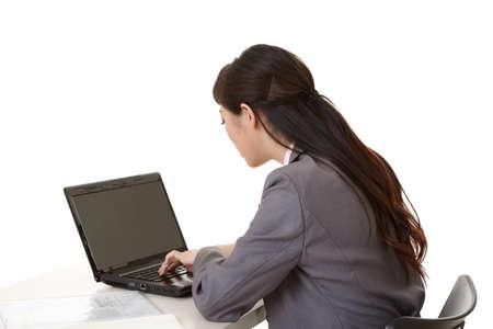 Asian business woman using laptop, rear view. photo