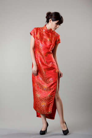 chipao: Chinese woman dress n traditional clothes, cheongsam, full length in studio. Stock Photo