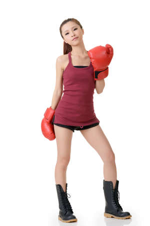 punched: Confident boxing girl of Asian, full length portrait on white background. Stock Photo