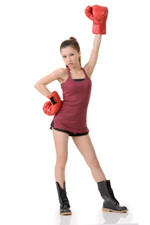 tough woman: Chinese boxing girl stand on white studio background, full length portrait.
