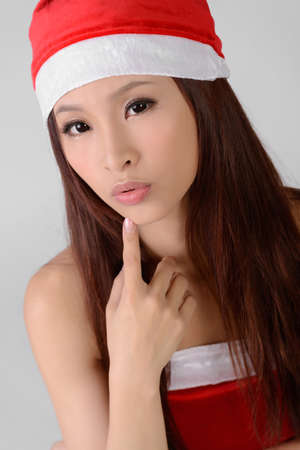 sexy asian woman: Asian Christmas girl, closeup portrait on white background.