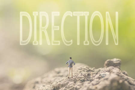 Concept of advice with a person stand in the outdoor and looking up the text over the sky in nature background. Stock Photo