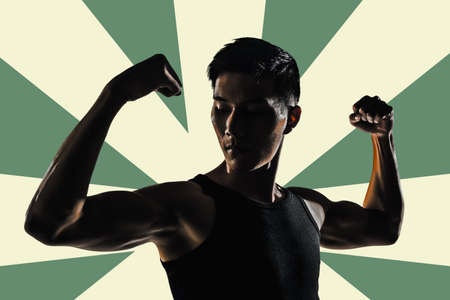 asian bodybuilder: Silhouette of young man show his biceps brachii, closeup portrait.