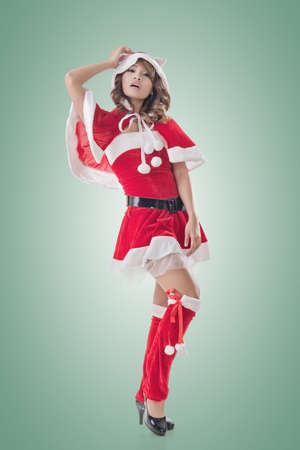 sexy christmas elf: Attractive Christmas lady of Asian woman, full length portrait. Stock Photo