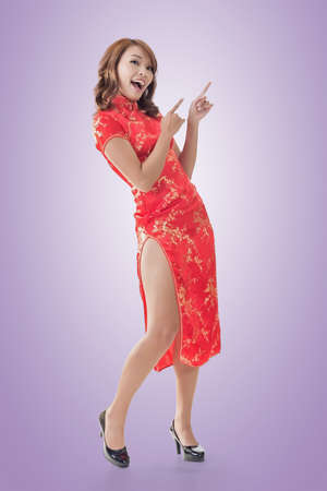 qipao: Chinese woman dress traditional cheongsam at New Year and introducing, full length portrait isolated.