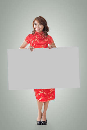 chipao: Attractive Chinese woman dress traditional cheongsam and hold blank board, full length portrait.